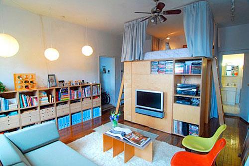 Спальное место над стеллажами для создания детской в гостиной
