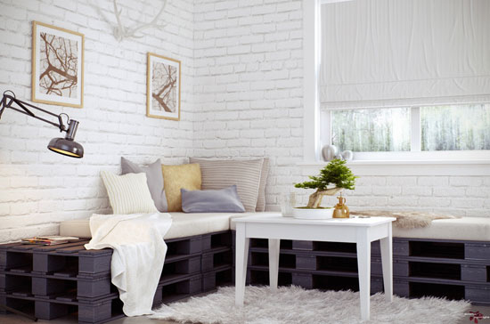 2-A-Magnificent-White-Interior-Space-Design-Has-Washed-Brickwork-A-Bonsai-Pallet-Sofa-A-Rectangle-Table-Colored-Pillows-An-Arm-Lamp-A-Hartshorn-Wall-A-Hairy-Rug-and-Picture-Frames