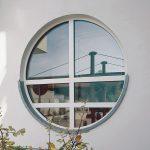 Фото 44: Откосы на круглое окно снаружи