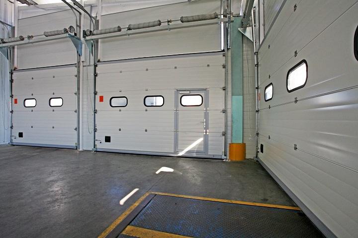 Торсионная балансировка полотна гаражных ворот секционного типа