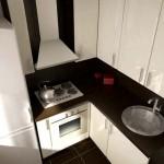 Фото 9: Недопустимое положение газовой плиты около холодильника