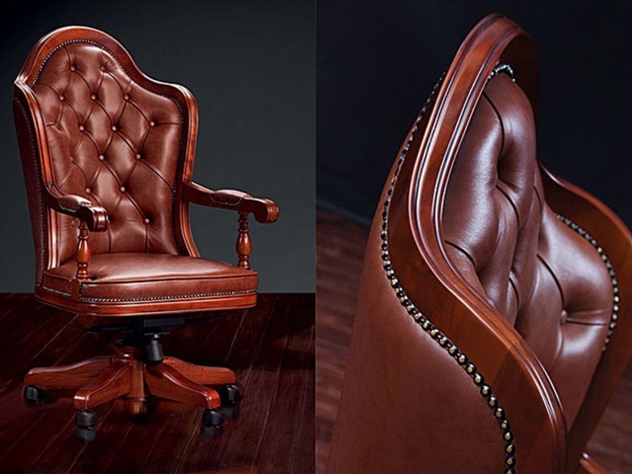 Кресло офисное на колесиках из кожи