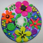Фото 42: Открытка–аппликация из пластилина на диске на 8 марта