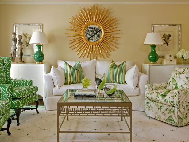 Traditional-green-living-room-with-big-sun-mirror-also-elegant-floral-sofa-byTobi-Fairley