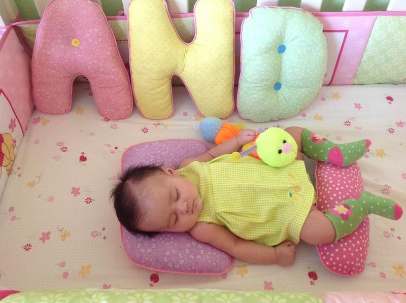 Буквы - подушки в детской кроватке