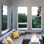 Серый диван у окна