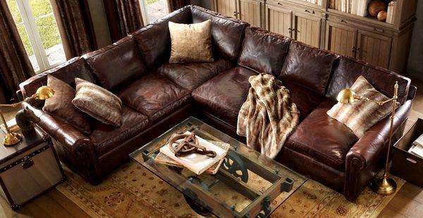 Большой коричневый диван фото