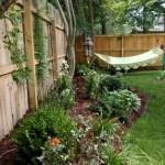 Фото 129: Садовая клумба с гамаком