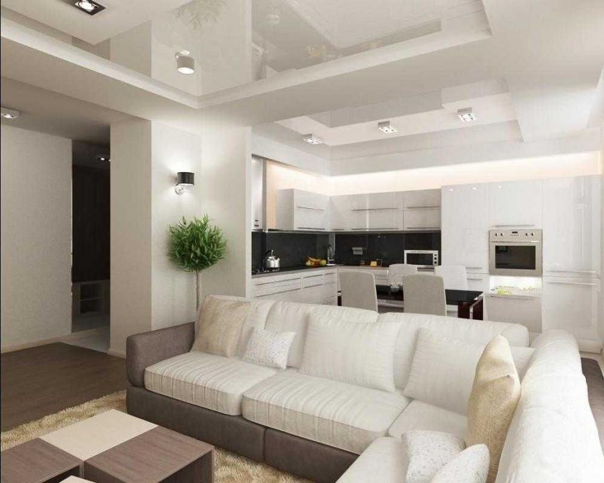 Зонирвоание кухни-гостиной с помощью дивана