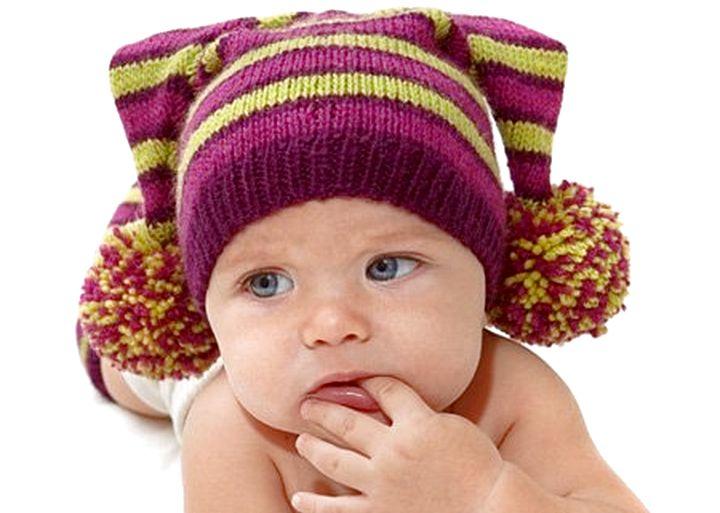 Эффектные и комфортные шапочки для детей связанные спицами