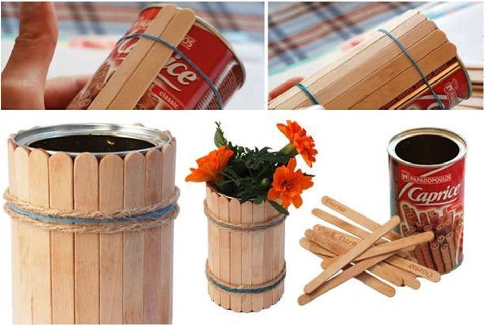 Изготовить вазу можно с помощью банки от кофе и палочек от мороженого