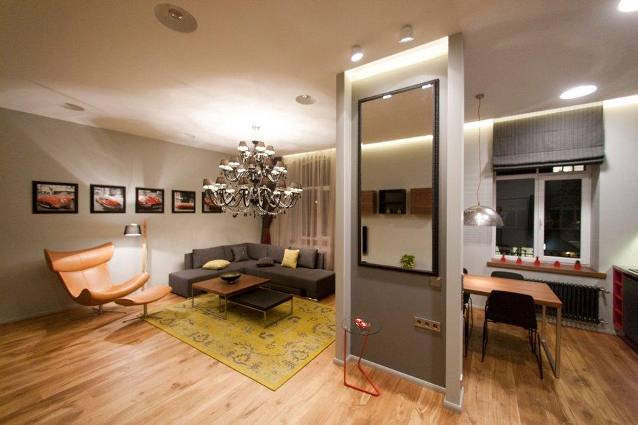 Основу гостиной составляет диван-трансформер, кресла и телевизор