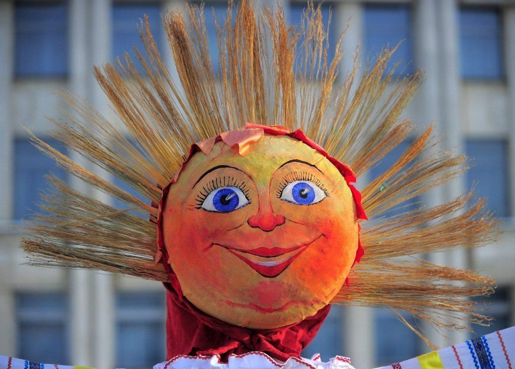 Голова масленицы в виде солнца