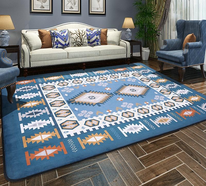 Ковры-прямоугольники часто призваны выделять область на полу рядом с креслами или диваном