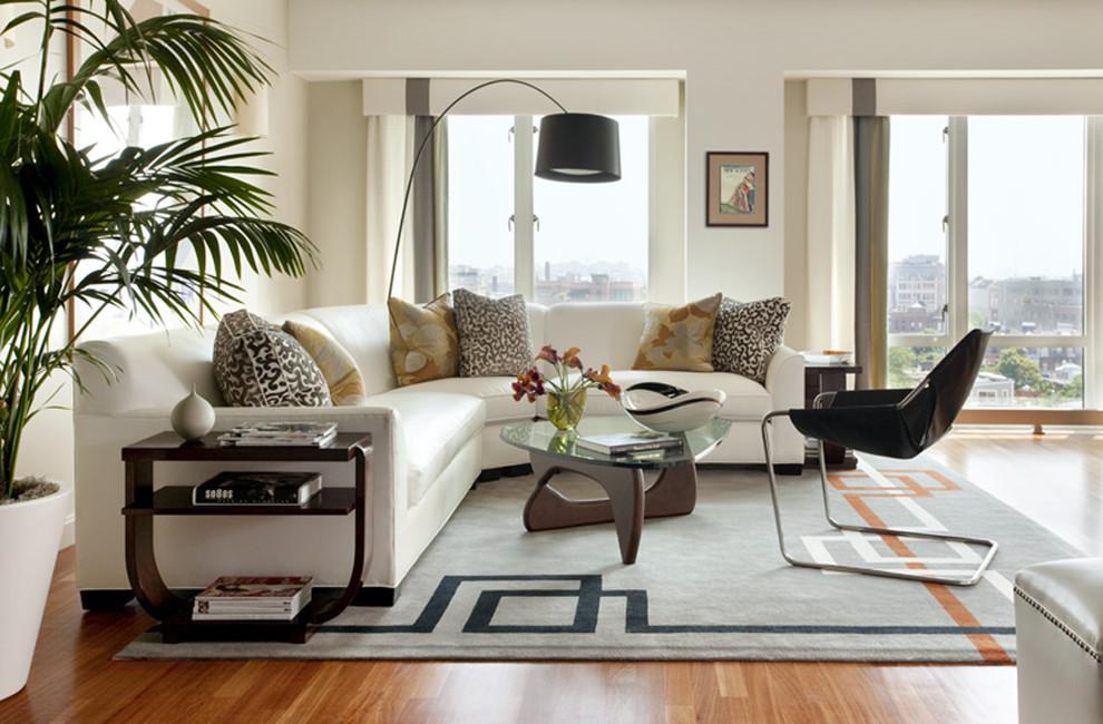 Для комнаты в стиле модерн лучше выбрать днотонный ковр с неким авангардистским символом либо геометрическим узором