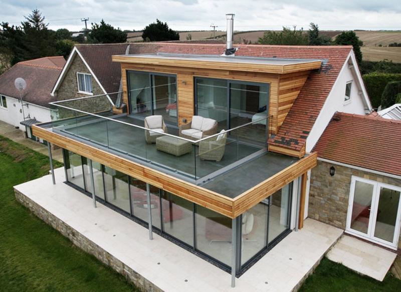 Комбинирование скатной и плоской крыши