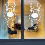 Фото 32: Олени на окне с помощью трафаретов